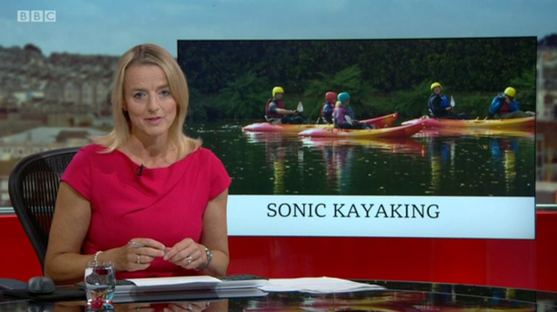 BBC spotlight presenter with sonic kayaks in the background image